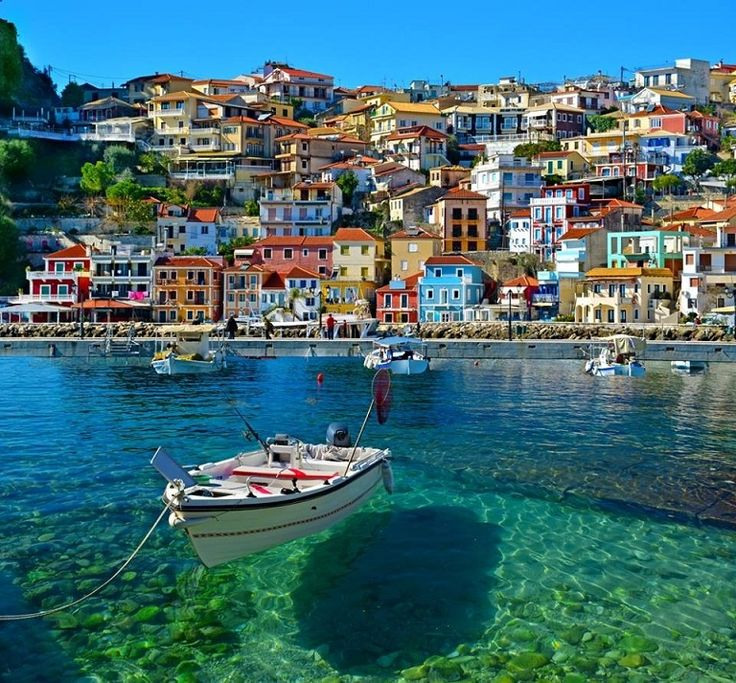 Beautiful Photo of Parga, Greece--looks like the boat is floating on air