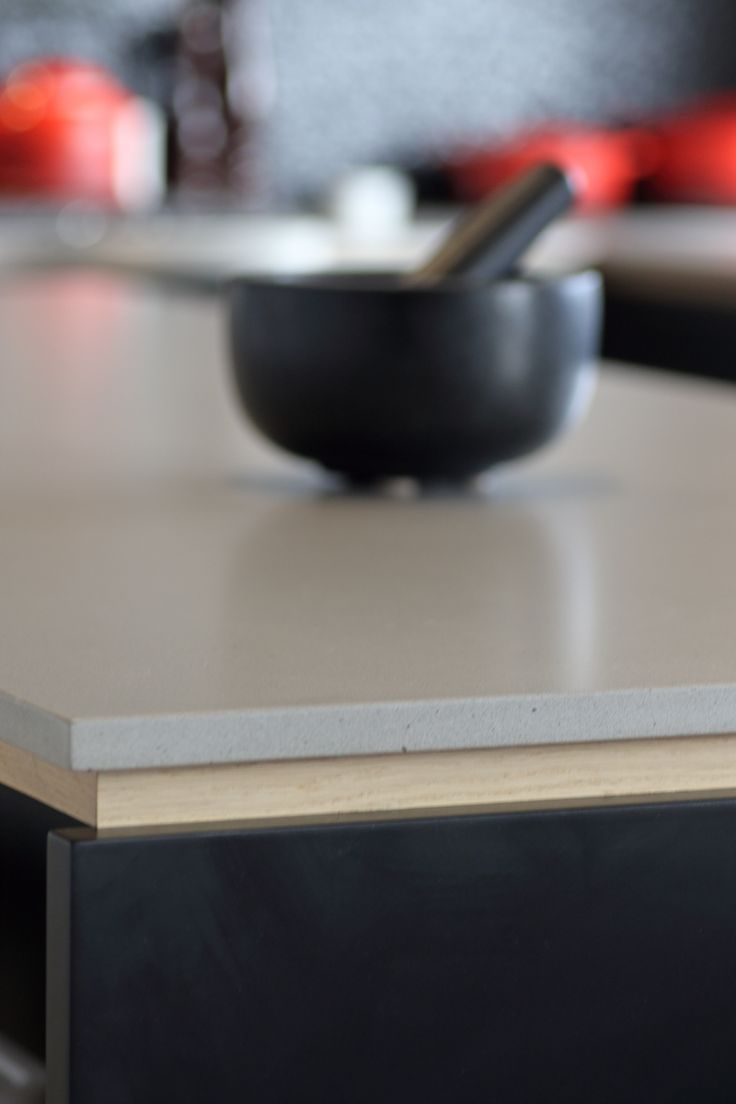 "Sally Steer Design Wellington, New Zealand. Caesarstone ""Raw Concrete"" with Oak negative detail."