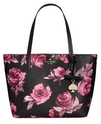 Romantic roses cover kate spade new york's signature tote complete with a minimalist interior that leaves room for larger items such as your laptop or tablet. A tab clasp closure secures the top with