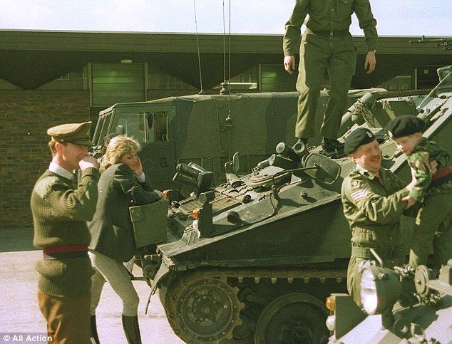 Fond looks: James Hewitt and Diana (left) watch Prince Harry (far right) during a visit to an Army base in 1989