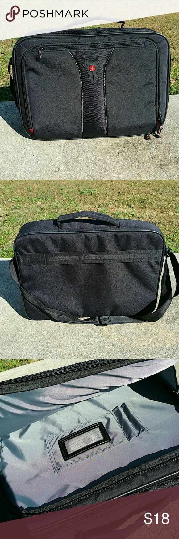 Laptop/Tablet Bag by Swiss Gear Black electronics bag/case can hold up to 15 inch laptop. Special sleeves for tablets and front pocket for Chargers, etc. Comes with shoulder strap for convenience. Very lightly used. Swiss Gear Bags Laptop Bags