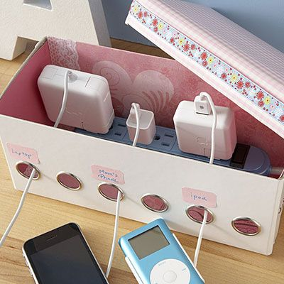 Another ribbon box, however, this one was decorated and then a power strip was popped inside to hide all of those pesky charging cords! ------------ Great idea for keeping out of children's hands!
