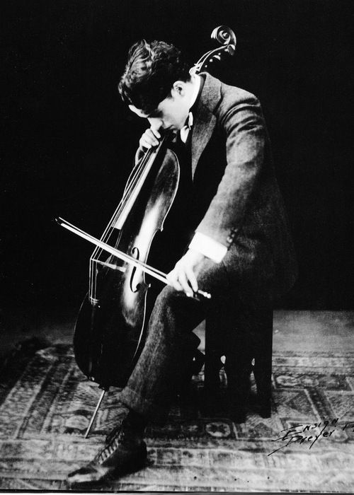 Charlie Chaplin playing his cello, Despite receiving two honorary Academy Awards, his only other Oscar was for the music score of Limelight, awarded in 1973.