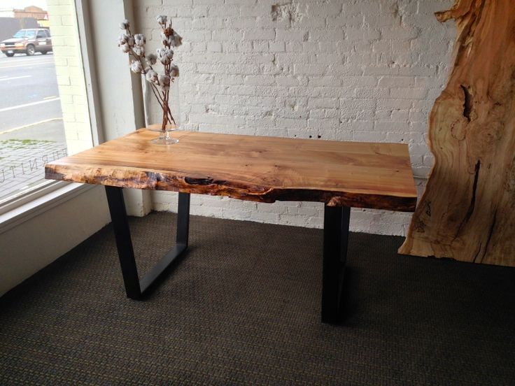 Churchwood Dining Table. 66-inches long. Tapered black metal legs.