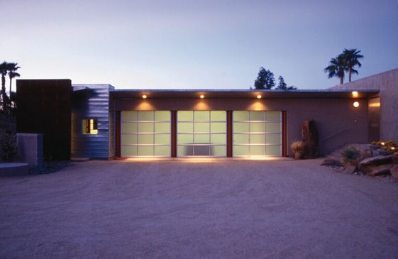 Desert glow at dusk. Clopay Avante Collection glass garage doors, clear anodized aluminum frame with frosted glass panels. www.clopaydoor.com