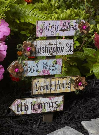 5 Adorable Fairy Garden Ideas To Make Right Now. Cute and imaginative, these clever directional signs will point you towards the closest fairy tale wonderland. We used Mod Podge Mod Melts and a Plaid Wood Surface to whip up this fun sign post, and we can't wait to find Fairy Blvd.