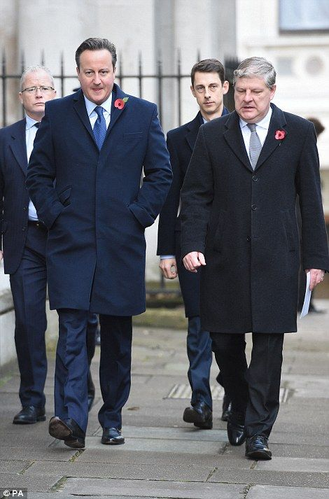 Former Prime Minister David Cameron (left) walks through Downing Street on his way to the annual Remembrance Sunday Service