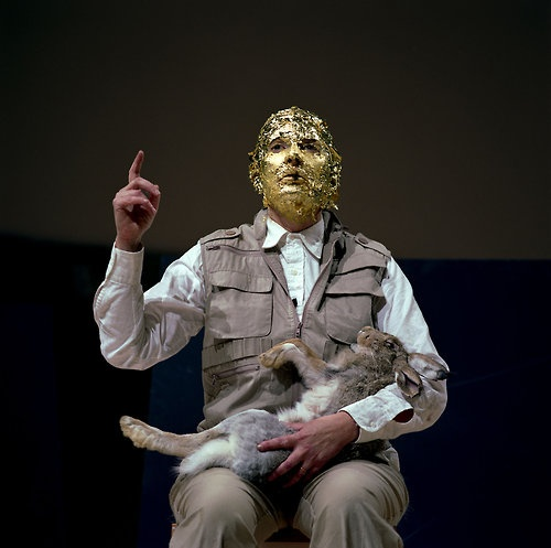 """Marina Abramovic after Joseph Beuys' """"How to Explain Pictures to a Dead Hare."""""""