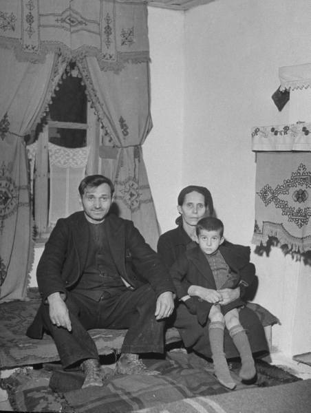 Civil War/Greece  The head council of Kastinoa sitting at home with his wife and grandson.Location:Louzesti, Greece  Date taken:December 1947  Photographer:John Phillips