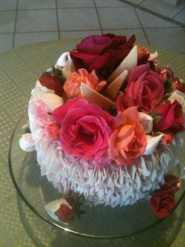 Fresh flowers, meringues, choc dipped berries, coconut shards covered this raspberry butter cream layered & frosted lemonade cake I loved making for my daughter's special birthday.