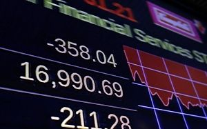 A screen on the floor of the New York Stock Exchange shows the closing number for the Dow Jones industrial average, Thursday, Aug. 20, 2015. The DJIA slid 358 points, 2.1 percent, to 16,990. (AP Photo/Richard Drew)