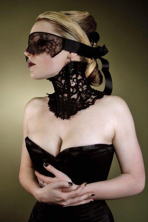 Elegant Victorian-inspired black neck corset and mask.