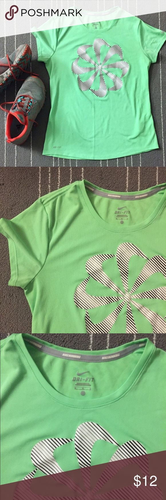 Nike women neon green running top with logo flower Nike women green running top. In excellent condition. Worn it few times. Color is more like neon green. Shorts sleeves. Size is M. Nike Tops Tees - Short Sleeve