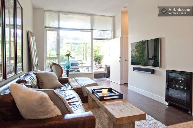 """60"""" Samsung wall mounted TV and Sonos sound system with recessed TV cabinet Sanus rack"""