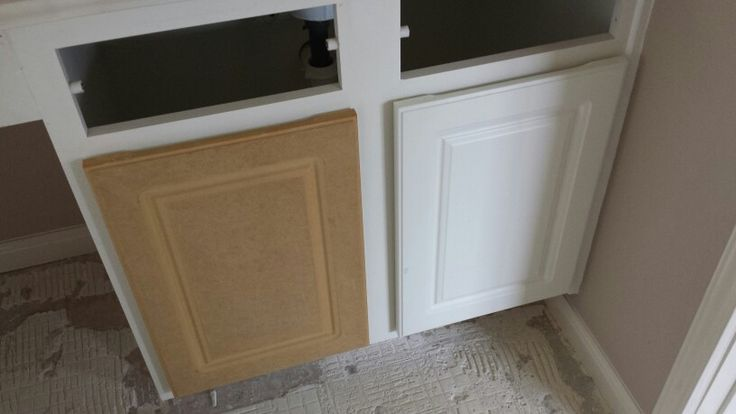 White Kitchen Cabinets Have A Plastic White Coating Over It