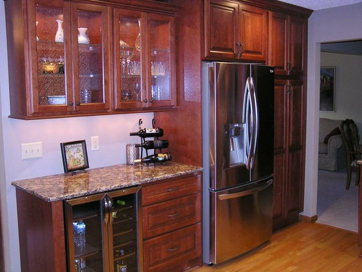 This Kitchen In Apple Valley Features A Glass Cabinet For Showing Off Fancy  Pieces, As