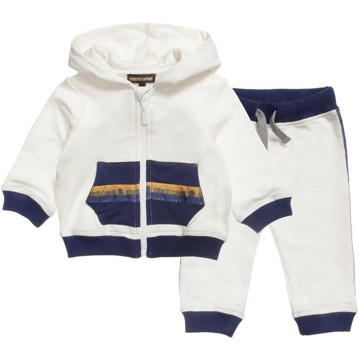 Roberto Cavalli baby boys ivory tracksuit featuring a hooded sweatshirt and trousers, both with blue and orange 'Roberto Cavalli' grosgrain ribbon trims. They are made from soft cotton jersey with a fleecy inside, the zip-up top has a large 'RC' logo print o the back and the trousers have a comfortable elasticated waist.