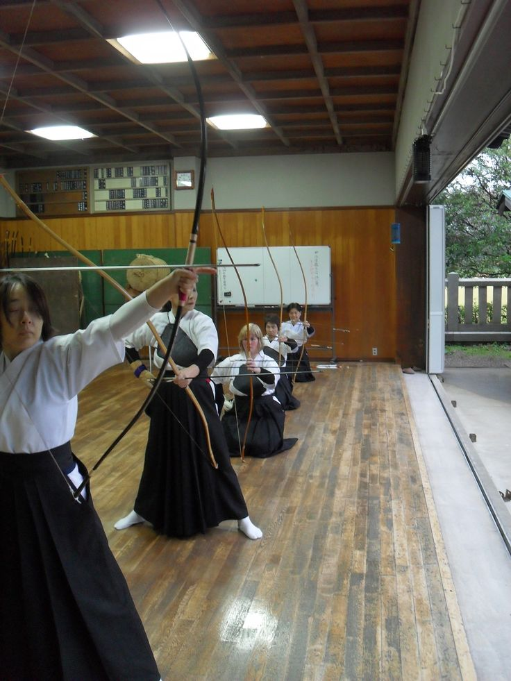 Shelby Barbe: Kyudo, as the picture shows, is Japanese archery. I was lucky enough to be taught by a very good teacher all about this art. Kyudo is a very traditional and spiritual art and works toward ones spiritual energy rather than hitting the target perfectly every time. The kanji or Japanese symbols, for Kyudo literally means bow art.  (弓道). I am positioned as third person in the line. This photo was taken at a very old Dojo(道場)in an old Japanese Shrine.