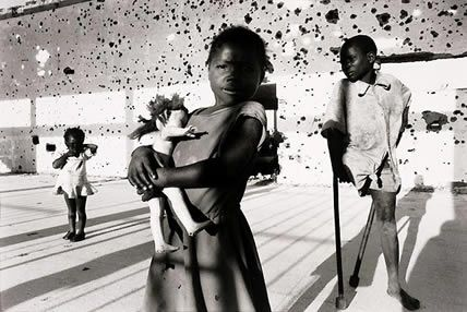 1996. Kids who are shocked by the civil war in Angola.