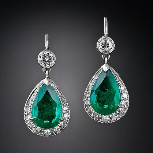 A beautifully matched pair of vibrant, bright-green pear-shape emeralds, weighing 3.50 carats total, are presented in classic style in these tasteful and timeless platinum and diamond eardrops, newly created to emulate their early-twentieth century forerunners. The leverbacks, per usual, are in white gold. The earrings measure 3/4 inch long by 3/8 inch wide. Colorful and stunning!