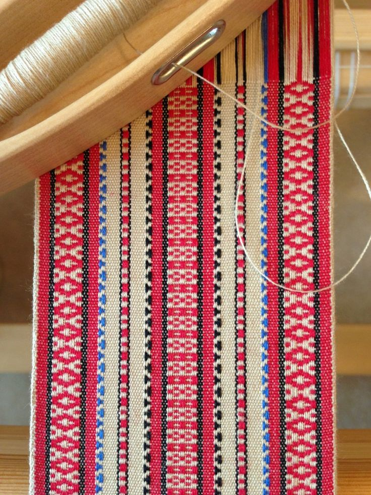 handwoven rosepath band turned traditional threading to weft and thread the pattern making it a warp faced weave.