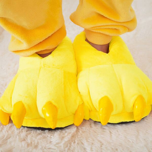 Bring some fun to your sleepwear ensemble with these bold and bright monster slippers from Onesieful. These oversized yellow slippers look just like monster cla Bold Yellow Monster Slippers  | Onesieful