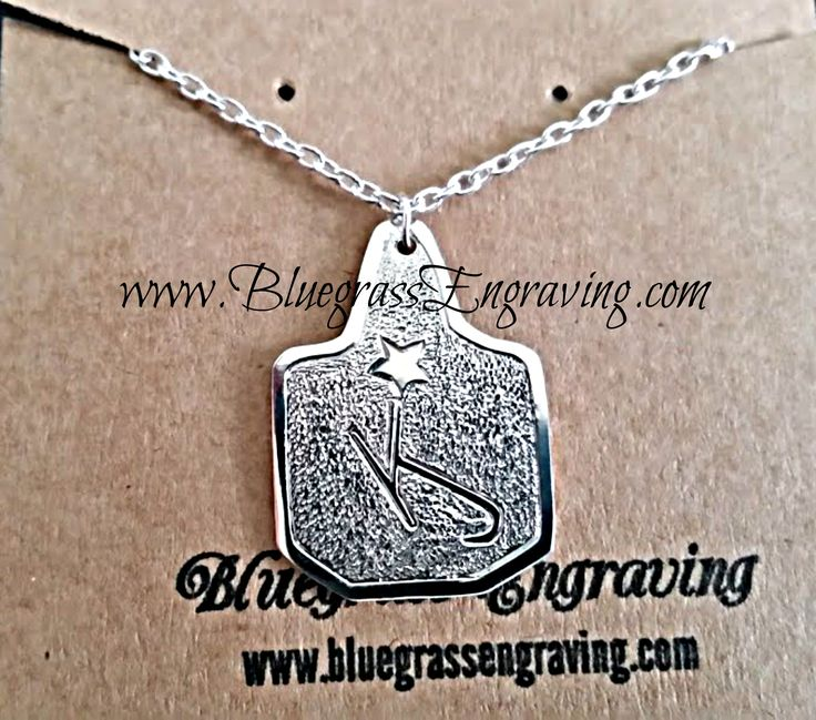Cattle tag pendant with custom brand. 100% hand crafted, hand engraved. Unique personalized jewelry available at www.bluegrassengraving.com.