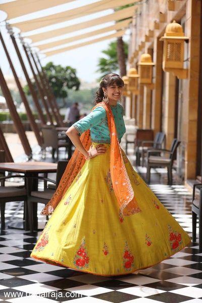 Light Lehengas - Yellow Lehenga with Red Floral Embroidery | WedMeGood | Twirling Bride in a Yellow Lehenga with Aqua Blue Blouse and Orange Net Dupatta  #wedmegood #indianbride #indianwedding #lehenga #mehendoutfit #mehandi #bridal #twirling #yellow #aqua #orange
