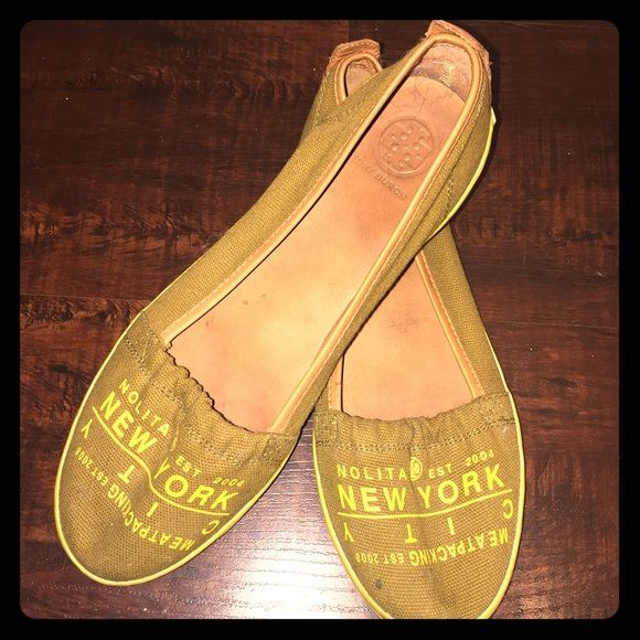 Tory Burch olive 'NYC' slip ons TORY BURCHsize 10 runs true to size Olive green base color with yellow writing on the toes canvas top, leather inside/sole easy breezy slip ons, that story Burch effortlessly chic look!can be dressed up or down I haven't worn these much, honestly about 5 times or less what you see is what you get, there are no damages to note.. Just a little light wear, a little stain or dust.. Nothing majoroffers encouraged Tory Burch Shoes Flats & Loafers