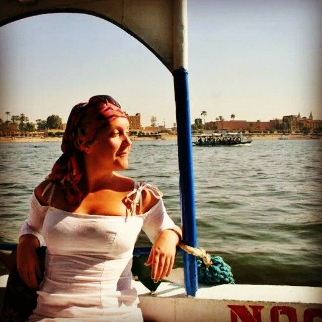 #throwbackthursday #tbt to vacation in January 2011, I'm in a boat on the Nile in Egypt. Wouldn't mind being there now #egypt #nile #vacation #riverboat #headscarf #style #whitelinendress