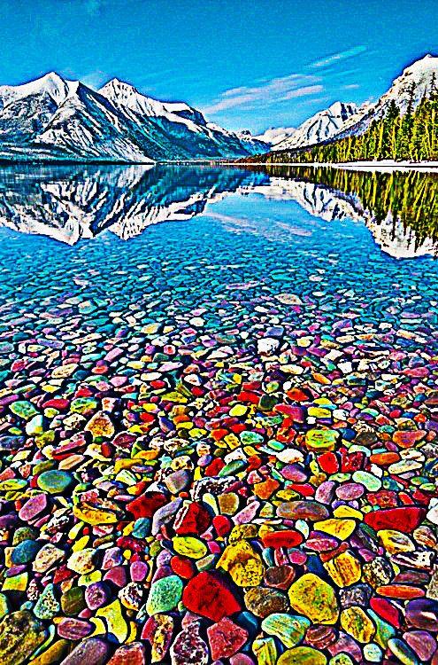Colorful Pebble Shore Lake In Glacier National Park