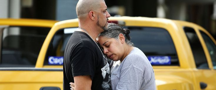 PHOTO: Ray Rivera, a DJ at Pulse Orlando nightclub, is consoled by a friend outside of the Orlando Police Department after a shooting involving multiple fatalities at the nightclub, June 12, 2016.