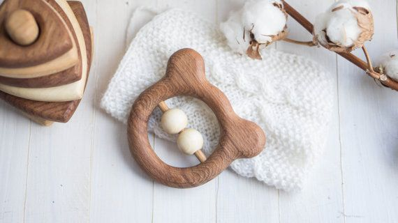 A wooden bear teether made of beech and covered with linseed oil is the ideal first toy for babies to grasp and chew. Sanded perfectly smooth. When