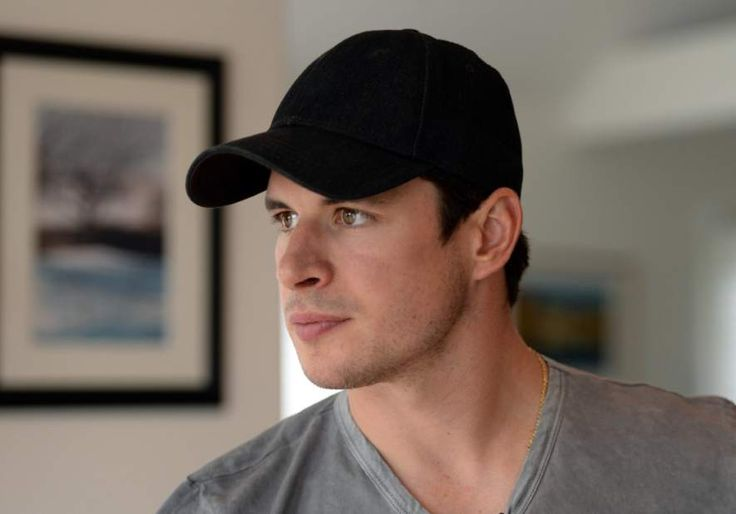 Penguins captain Sidney Crosby looks out the back of his house toward a lake Wednesday, Aug. 12, in Nova Scotia, Canada.