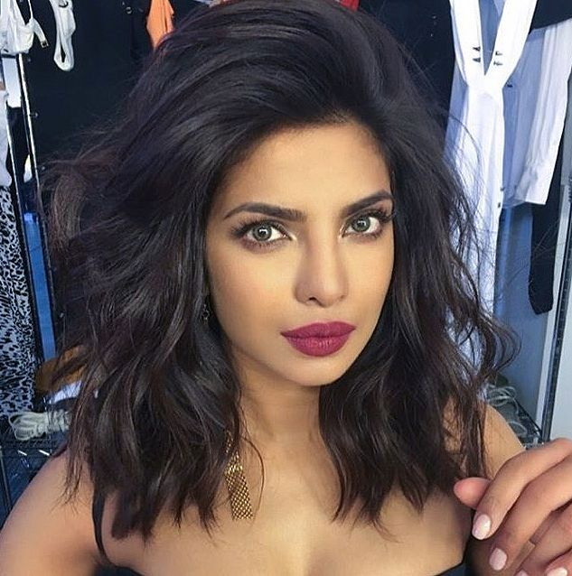 PRIYANKA: Side-Swept Waves: apply mousse to hair before you blow it out, it controls frizz and makes hair moldable, then blow hair up and over to one side (focusing on the roots) using a round brush and a blow dryer, before creating waves with a 1-in. curling iron.