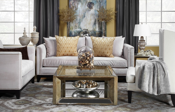 Make a bold impression with a gold and glamorous living room that is also warm and welcoming.