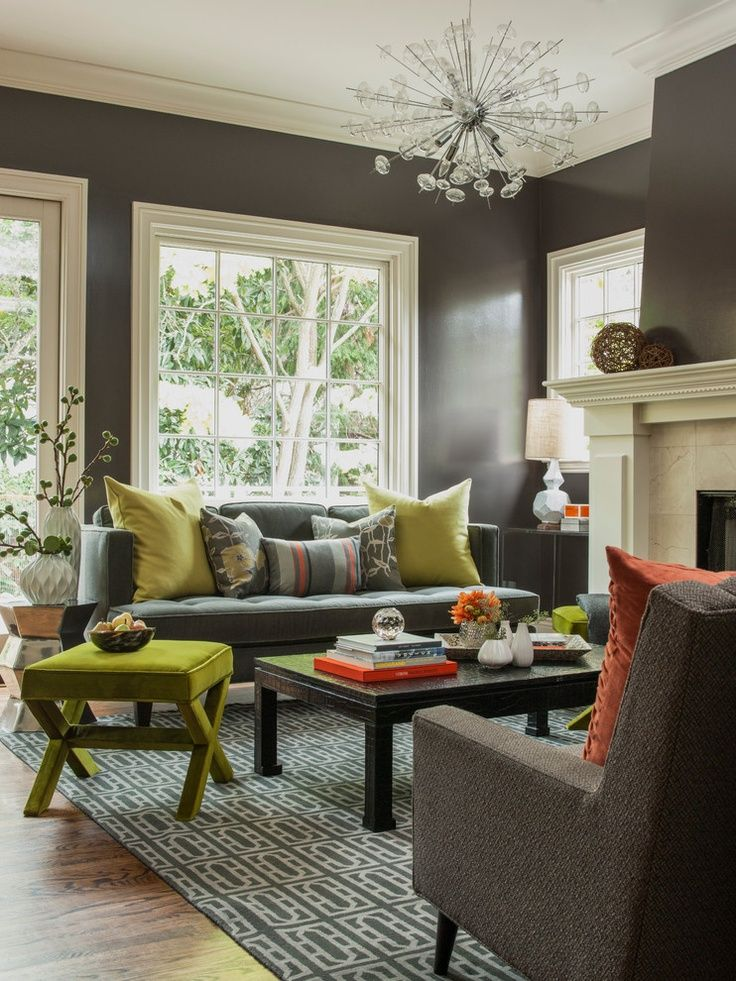 Modern living room with medium grey walls and chartreuse and pumpkin accents