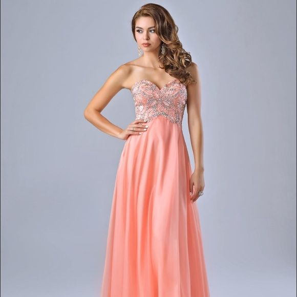 Prime dress worn once.  PRICE CAN BE NEGOTIATED Coral floor length dress with crystal and rine stone embroidery  WORN ONCE Dresses Prom