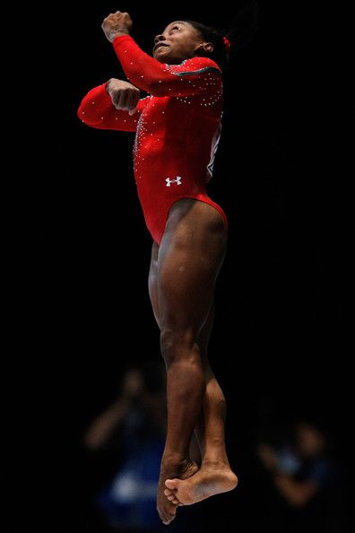 Simone Biles Photos Photos - Simone Biles of USA competes in the Womens Vault Qualification on  Day Three of the Artistic Gymnastics World Championships Belgium 2013 held at the Antwerp Sports Palace on October 2, 2013 in Antwerpen, Belgium. - Artistic Gymnastics World Championships: Day 3