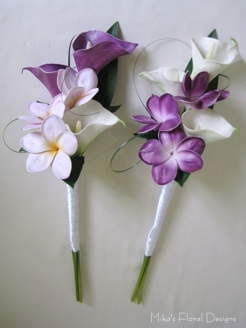 going to change the smaller flowers to the flowers im going to use in my wedding..but add an actual wand and use the white and purple calla lillies..love this