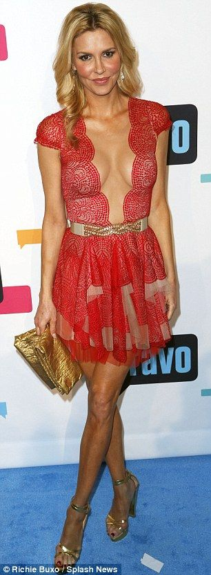 She's got some front! Brandi Glanville wears plunging frock to outshine her…