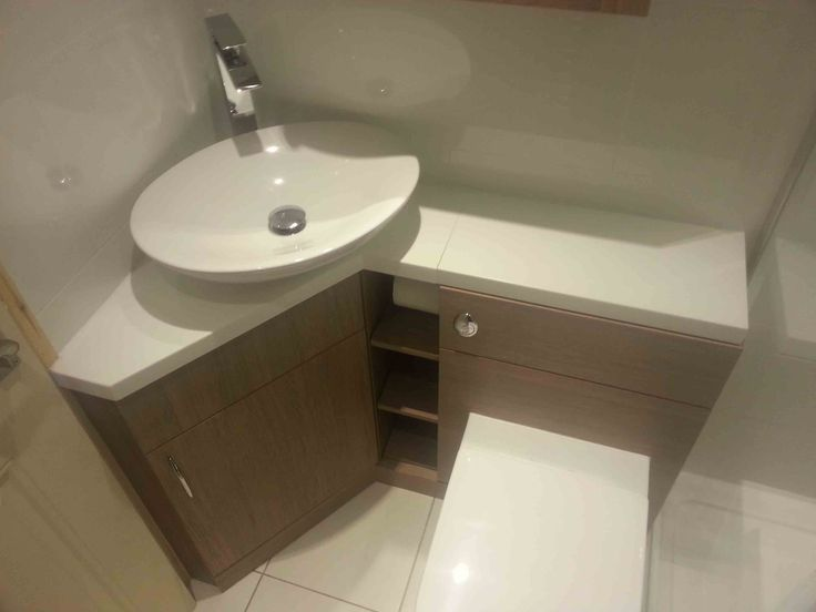 Brown Corner Bathroom Vanity With Spacious Wooden Drawers And Shelves  Furnished By The Luminous White Granite
