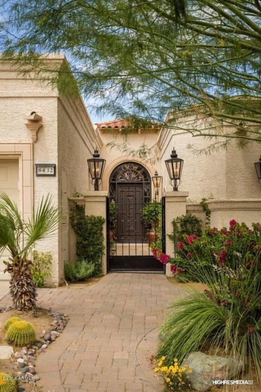 Mediterranean Front Door with Gate, Fence, Pathway, exterior brick floors