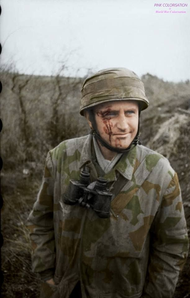 A lightly wounded German Fallschirmjäger (Green Devil paratrooper) grins for the camera during the Battle of Monte Cassino in Italia. (Monte Cassino battle : January 17th to May 19th 1944)
