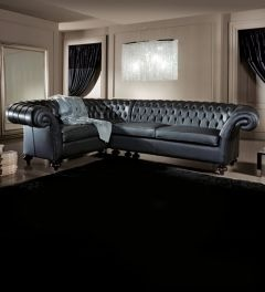 Diva Collection corner sofa shown here in black leather with onion legs turned in solid wood.