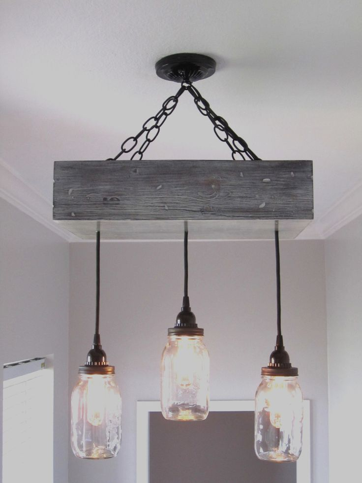 Add a rustic chandelier to your decor. www.outofthewdworkdesign.etsy.com