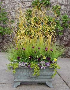 Amazing spring planter - wavy sticks and plastic grass - Detroit Garden Works