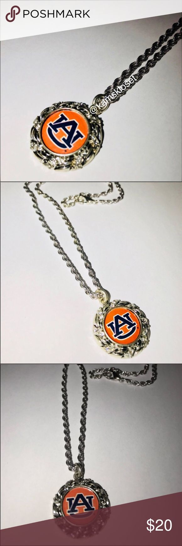 """Auburn University Silver Oval Logo Necklace This beautiful """"Au"""" logo necklace is perfect to wear on game days or to gift for that dedicated fan! Oval Pendant has blue and orange """"AU"""" logo with """"crystal"""" accents around oval. Silver chain measures 18.5"""" long with lobster claw closure! Bundle and Save! Jewelry Necklaces"""