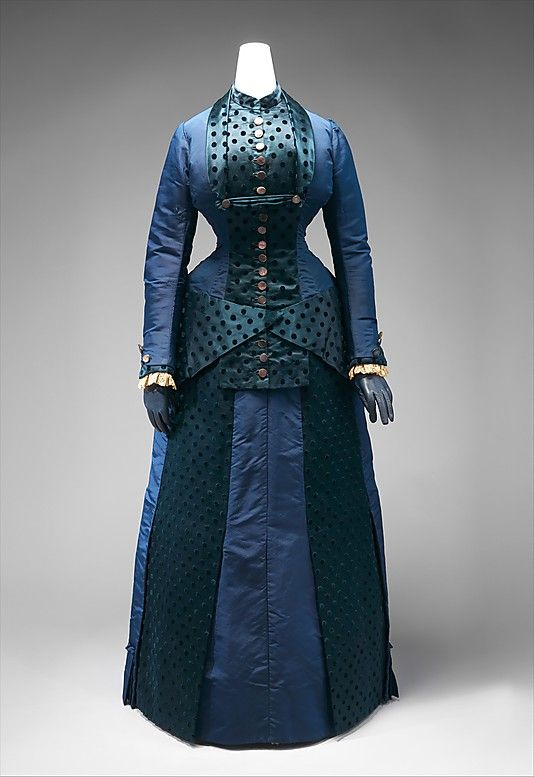 Early 1880s American Dress at the Metropolitan Museum of Art, New York - Note how this dress was mounted with a pair of gloves.