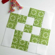 Block 112 - Rolling Nine Patch. August 2017 block from the Fat Quarter Shop's charity quilt-along.